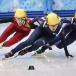 From left, Fan Kexin of China, Park Seung-hi of South Korea and Shim Suk-Hee of South Korea compete in the women's 1000m short track speedskating final at the Iceberg Skating Palace during the 2014 Winter Olympics, Friday, Feb. 21, 2014, in Sochi, Russia. (AP Photo/Bernat Armangue)